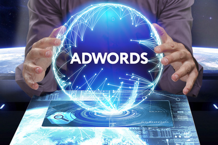 Business, Technology, Internet and network concept. Young businessman shows the word on the virtual display of the future: AdWords